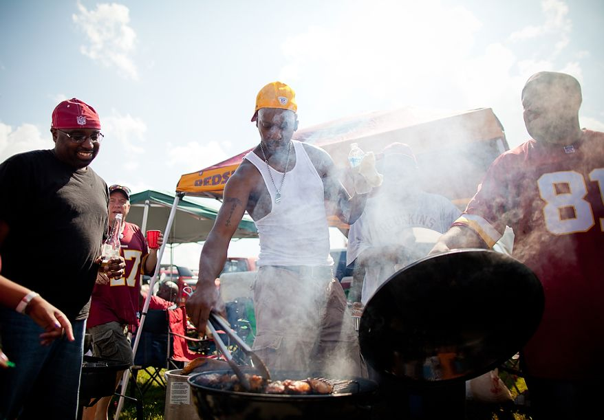 Robbi Burton (center) of Ft. Washington, Md. tailgates before the Washington Redskins vs. New York Giants game at FedEx Field in Landover, Md. Sunday, September 11, 2011. Burton is a six-year season ticket holder. (Pratik Shah / The Washington Times)