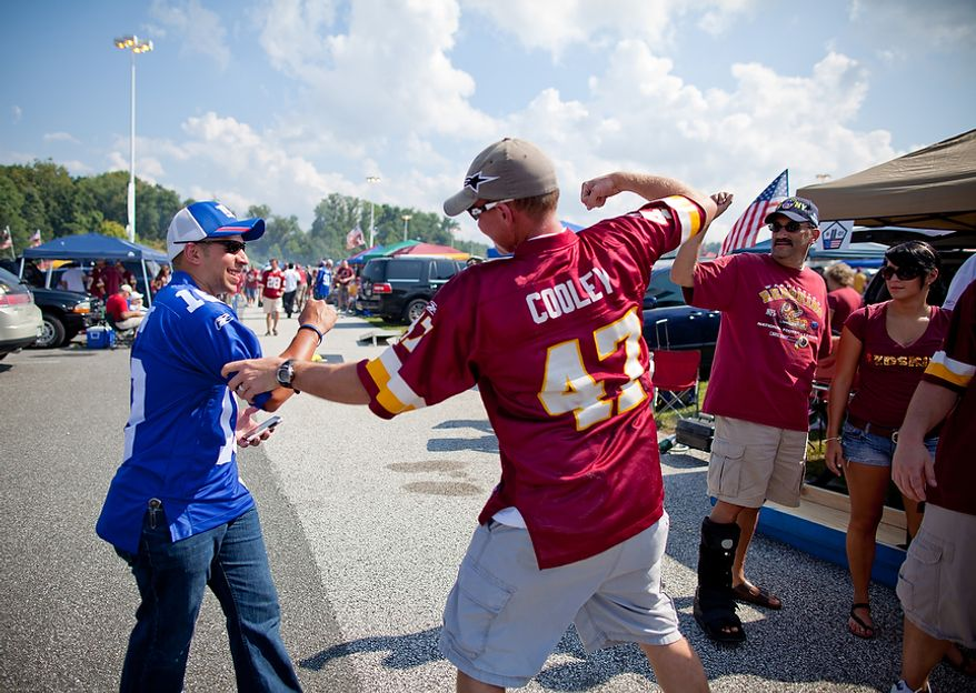 Talsey Cunningham (right) jokes around with friend and New York Giants fan Tyler Johnson (left) while they tailgate before the Washington Redskins play the New York Giants at FedEx Field in Landover, Md. Sunday, September 11, 2011. (Pratik Shah / The Washington Times)