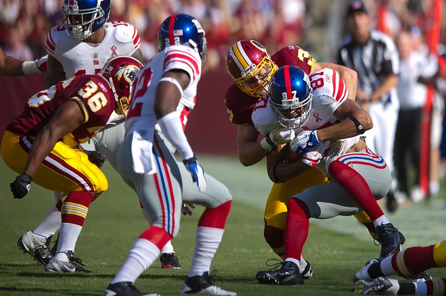 Washington Redskins S Reed Doughty (37) takes down New York Giants WR Domenik Hixon (87) after a gain of 9 yards during the 1st quarter at FedEx Field in Landover, Md. Sunday, September 11, 2011. (Andrew Harnik / The Washington Times)
