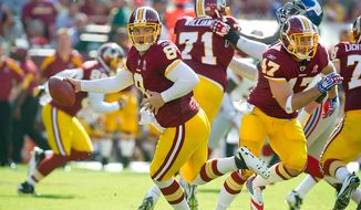 Washington Redskins QB Rex Grossman (8) looks for an open runner against the New York Giants during the 1st quarter at FedEx Field in Landover, Md. Sunday, September 11, 2011. (Rod Lamkey Jr. / The Washington Times)