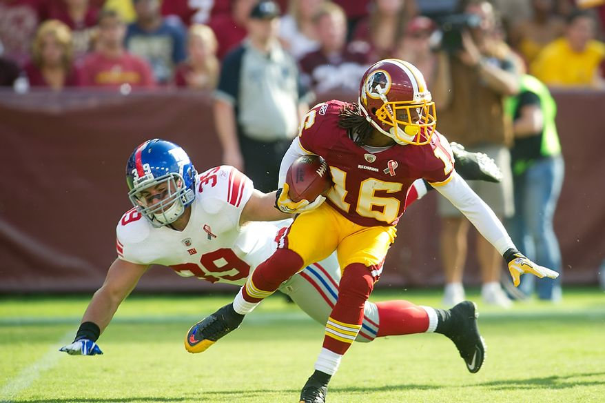 Washington Redskins WR Brandon Banks (16) picks up 25 yards on a punt return against the New York Giants during the 1st quarter at FedEx Field in Landover, Md. Sunday, September 11, 2011. (Rod Lamkey Jr. / The Washington Times)