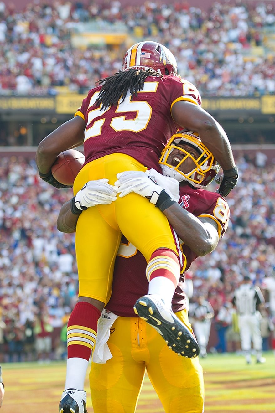 Washington Redskins RB Tim Hightower (25) celebrates his touchdown with teammate Fred Davis (83) against the New York Giants to tie the game at 7-7 during the 2nd quarter at FedEx Field in Landover, Md. Sunday, September 11, 2011. (Rod Lamkey Jr. / The Washington Times)