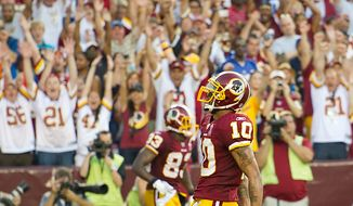 Washington Redskins WR Jabar Gaffney (10) celebrates after his touchdown against the New York Giants during the 4th quarter bringing his team up 27-14 at FedEx Field in Landover, Md. Sunday, September 11, 2011. (Rod Lamkey Jr. / The Washington Times)