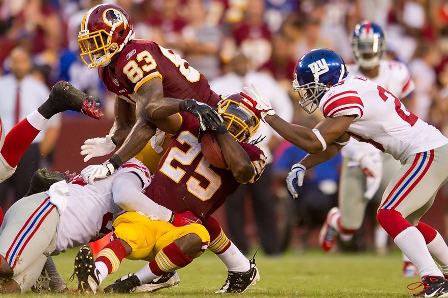 Washington Redskins RB Tim Hightower (25) runs the ball and runs out the clock against the New York Giants during the 4th quarter at FedEx Field in Landover, Md. Sunday, September 11, 2011. (Andrew Harnik / The Washington Times)