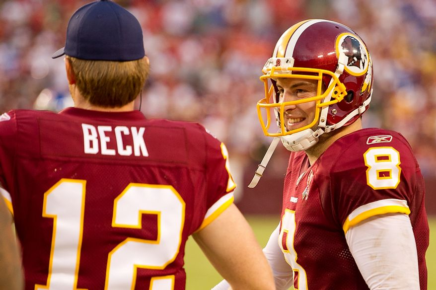 Washington Redskins quarterbacks Rex Grossman (8) and John Beck (12) talk on the sidelines during play against the New York Giants during the 4th quarter at FedEx Field in Landover, Md. Sunday, September 11, 2011. (Andrew Harnik / The Washington Times)