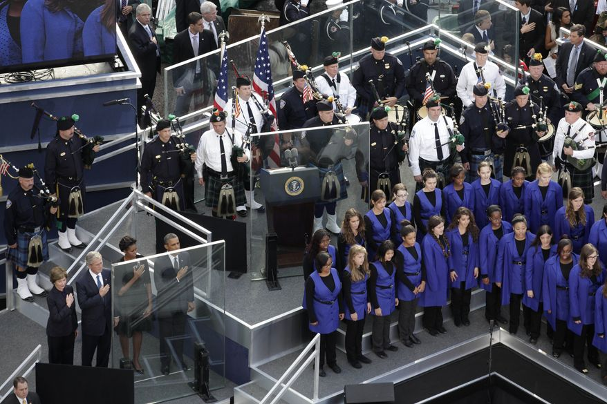 Standing for the national anthem at the ceremony in New York on Sunday, Sept. 11, 2011, to mark the 10th anniversary of the 9/11 attacks are (from lower left) former first lady Laura Bush, former President George W. Bush, first lady Michelle Obama and President Obama. (AP Photo/Mark Lennihan)