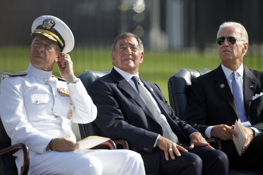 Vice President Joseph R. Biden Jr. (right), Defense Secretary Leon E. Panetta (center) and Adm. Mike Mullen, chairman of the Joint Chiefs of Staff, participate in a ceremony on Sunday, Sept. 11, 2011, at the Pentagon to honor victims of the Sept. 11 attacks. (AP Photo/Charles Dharapak)