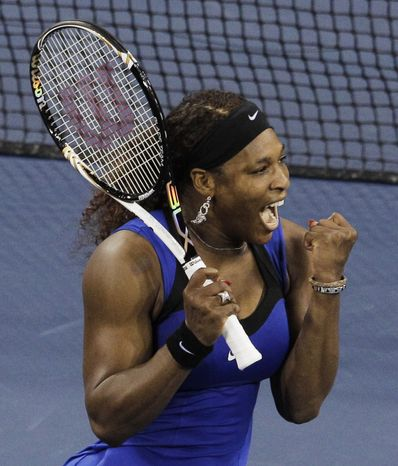Serena Williams reacts after winning her semifinal match against Caroline Wozniacki of Denmark at the U.S. Open in New York on Saturday, Sept. 10, 2011. (AP Photo/Charlie Riedel)