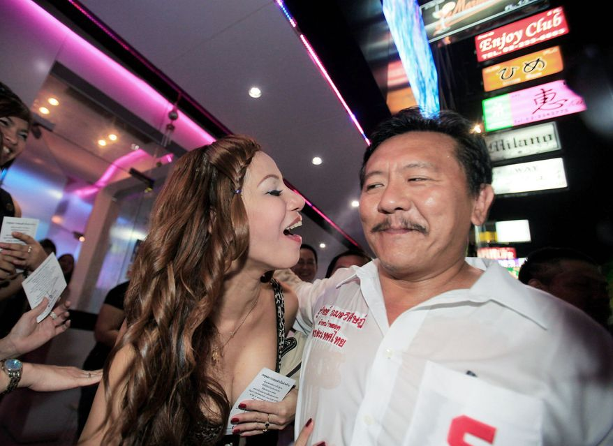 """THE 'EXPERT': Former massage parlor owner Chuvit Kamolvisit, elected to parliament in July, is fighting the kind of crime he used to promote. He speculates that """"100 percent"""" of Thailand's illegal casinos pay bribes to the police. (Associated Press)"""