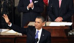 President Obama arrives to deliver a speech to a joint session of Congress at the Capitol in Washington on Sept. 8, 2011. Watching are Vice President Joseph R. Biden Jr., and House Speaker John Boehner. (Associated Press)