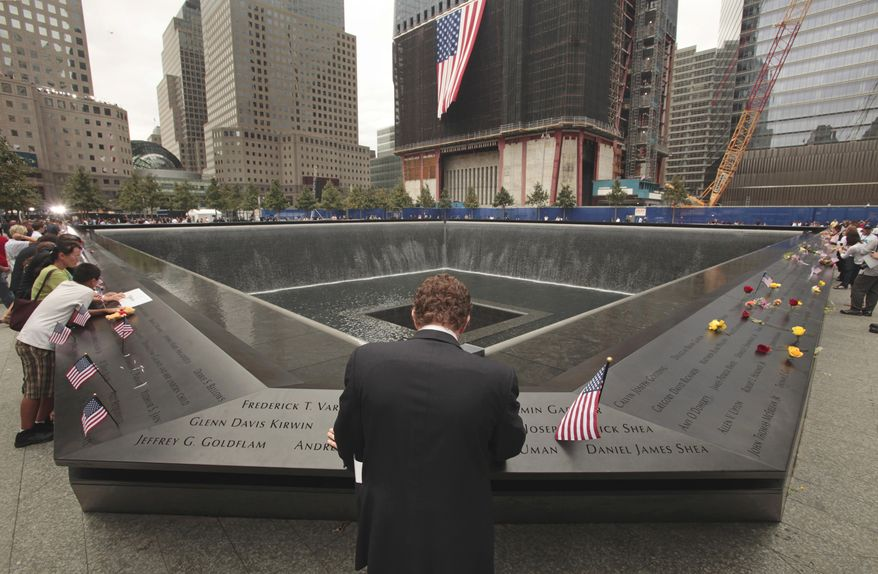 Michael Lehrman, executive managing director of Cantor Fitzgerald and Co., bows his head at one of two memorial pools at ground zero in New York on Sunday, Sept. 11, 2011, the 10th anniversary of the Sept. 11 attacks. More than 600 employees from Cantor Fitzgerald lost their lives in the attacks on the World Trade Center's twin towers. (AP Photo, Carolyn Cole, Pool)