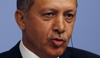 **FILE** In this photo from Sept. 6, 2011, Turkish Prime Minister Recep Tayyip Erdogan speaks to the media in Ankara, Turkey. (Associated Press)