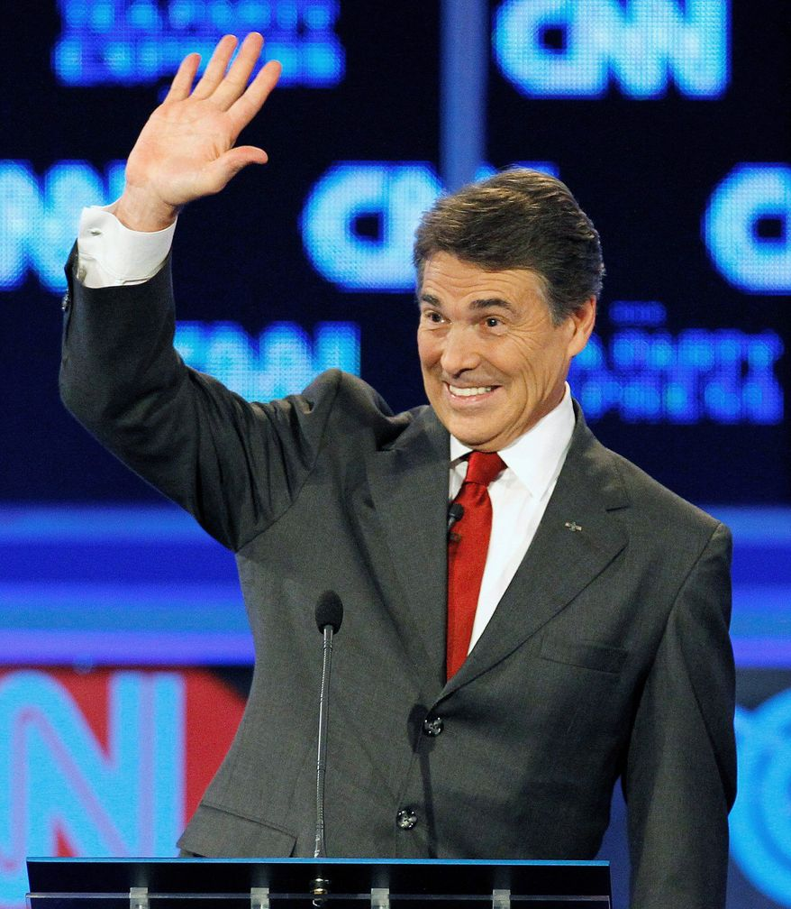 Republican presidential candidate Texas Gov. Rick Perry acknowledges the audience after a GOP presidential debate Monday in Tampa, Fla. He is scheduled to be a featured guest at a Virginia Republican Party fundraiser Wednesday. (Associated Press)