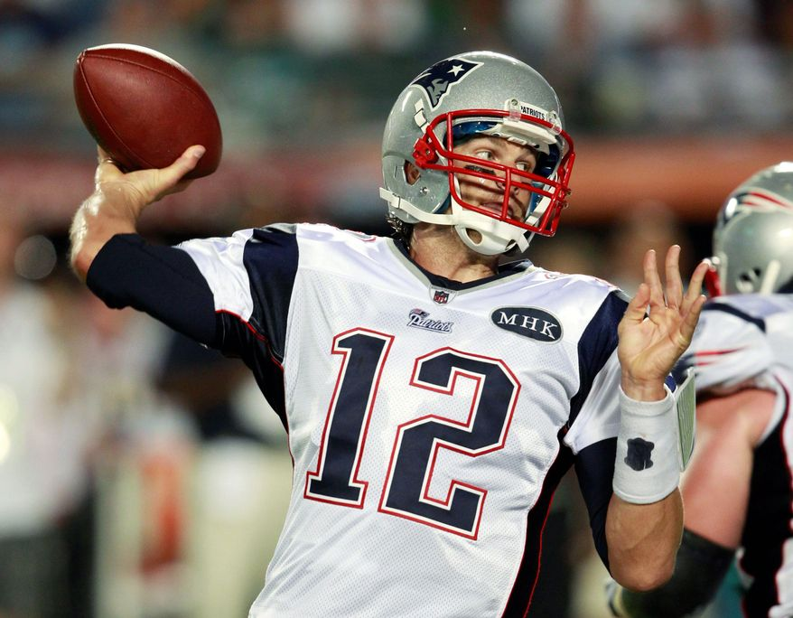 Tom Brady passed for four touchdowns Monday night in the Patriots' win against the Dolphins, including a 99-yarder to Wes Welker. (Associated Press)