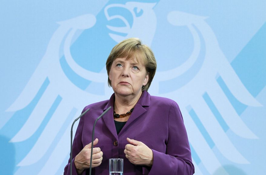 German Chancellor Angela Merkel gestures during a joint news conference with the Finnish Prime Minister Jyrki Katainen (not pictured) after a meeting at the Chancellery in Berlin on Tuesday, Sept. 13, 2011. Mrs. Angela Merkel sought to calm market fears that Greece is heading for a chaotic default on its debts as Europe struggles to contain a crippling financial crisis. (AP Photo/Michael Sohn)