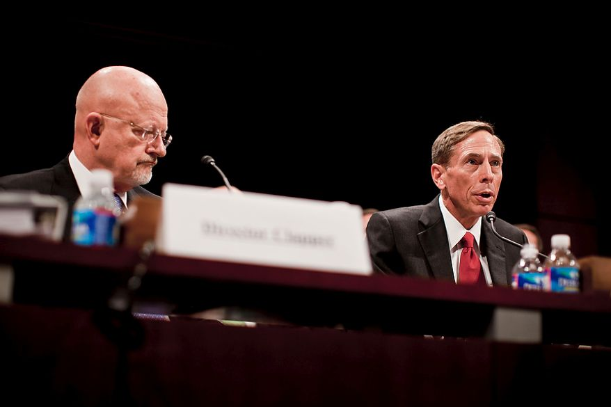 CIA Director David H. Petraeus (right) and James Clapper, director of national intelligence, testify during a joint hearing of the U.S. House and Senate intelligence committees at the U.S. Capitol in Washington on Tuesday, Sept. 13, 2011. The intelligence chiefs briefed lawmakers on the state of intelligence reform 10 years after the Sept. 11 attacks. (T.J. Kirkpatrick/The Washington Times)