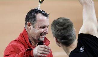 Red Sox hurler Tim Wakefield is congratulated Tuesday for his 200th big-league win. (Associated Press)