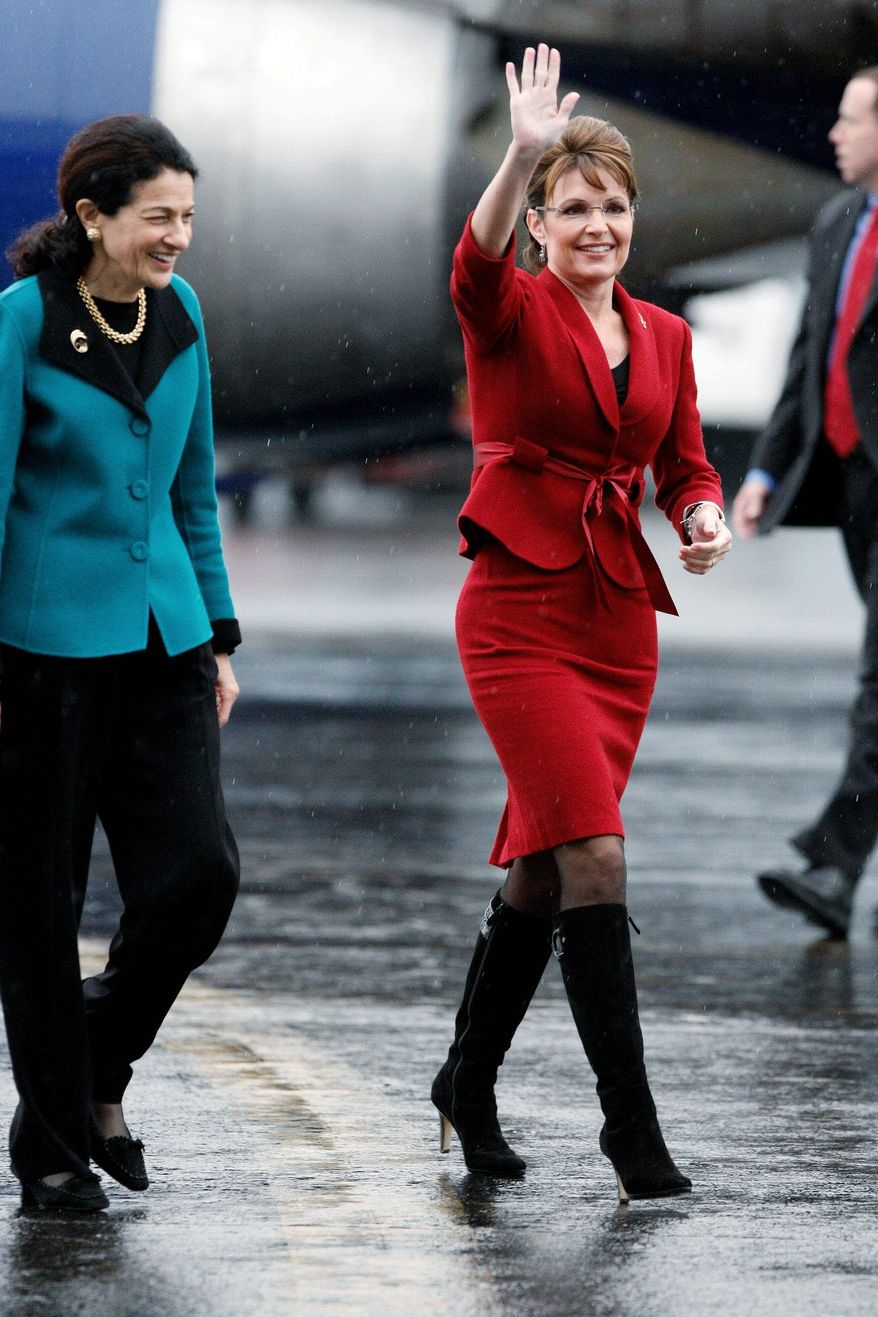Republican vice presidential nominee, Alaska Gov. Sarah Palin, right, with Sen. Olympia Snowe, R-Maine, arrive for a campaign stop at the Bangor Airport, Thursday, Oct. 16, 2008, in Bangor, Maine. (AP Photo/Robert F. Bukaty)