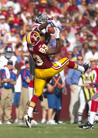 Washington Redskins tight end Fred Davis' first catch of the season was a highlight-reel 23-yard grab on a throw that was high and behind him. (Andrew Harnick/The Washington Times)