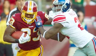 Washington Redskins tight ends Fred Davis and Chris Cooley shared the field for 21 of 64 plays against the New York Giants on Sunday. They combined for 126 yards on seven receptions as Washington opened the season with a 28-14 win. (Rod Lamkey Jr./The Washington Times)