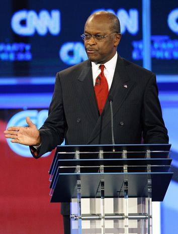 Republican presidential candidate Herman Cain gestures during a Republican presidential debate on Sept. 12, 2011 in Tamp