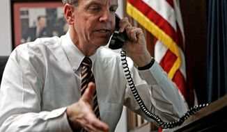 ** FILE ** Rep. Jerry Moran, R- Kan., talks on the phone with constituents in his Capital Hill office Monday, Jan. 29, 2007, in Washington. (AP Photo/Evan Vucci)