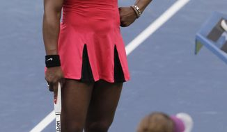 Serena Williams talks to the chair umpire Eva Asderaki during the women's championship match against Samantha Stosur of Australia at the U.S. Open tennis tournament in New York, Sunday, Sept. 11, 2011. (AP Photo/Mike Groll)