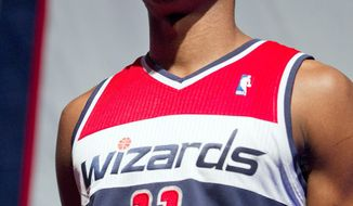 Washington Wizards basketball player John Wall shows off the new Wizards uniforms on Tuesday, May 10, 2011, in Washington. (AP Photo/Evan Vucci)