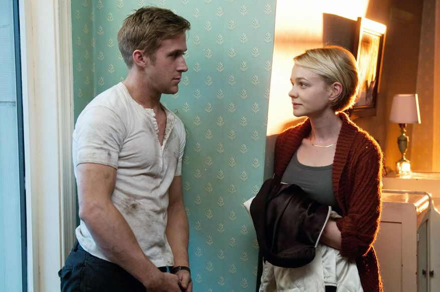 """Ryan Gosling and Carey Mulligan star in """"Drive,"""" a neo-noir action flick about a Hollywood stunt driver who drives getaway cars for criminals in his off-hours. (Film District via Associated Press)"""