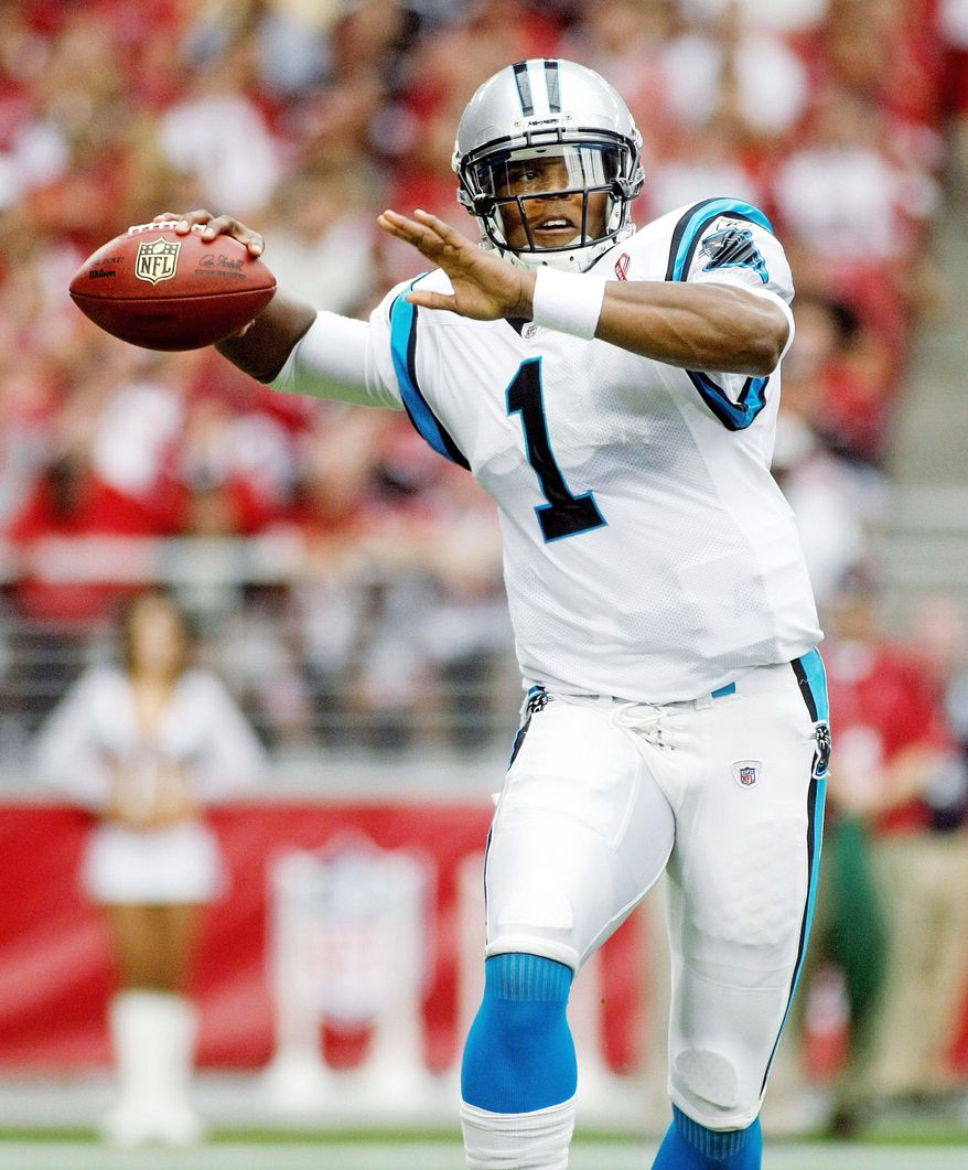 After passing for 422 yards Sunday, expect Panthers quarterback Cam Newton to come back down to earth this weekend against Green Bay. (Associated Press)