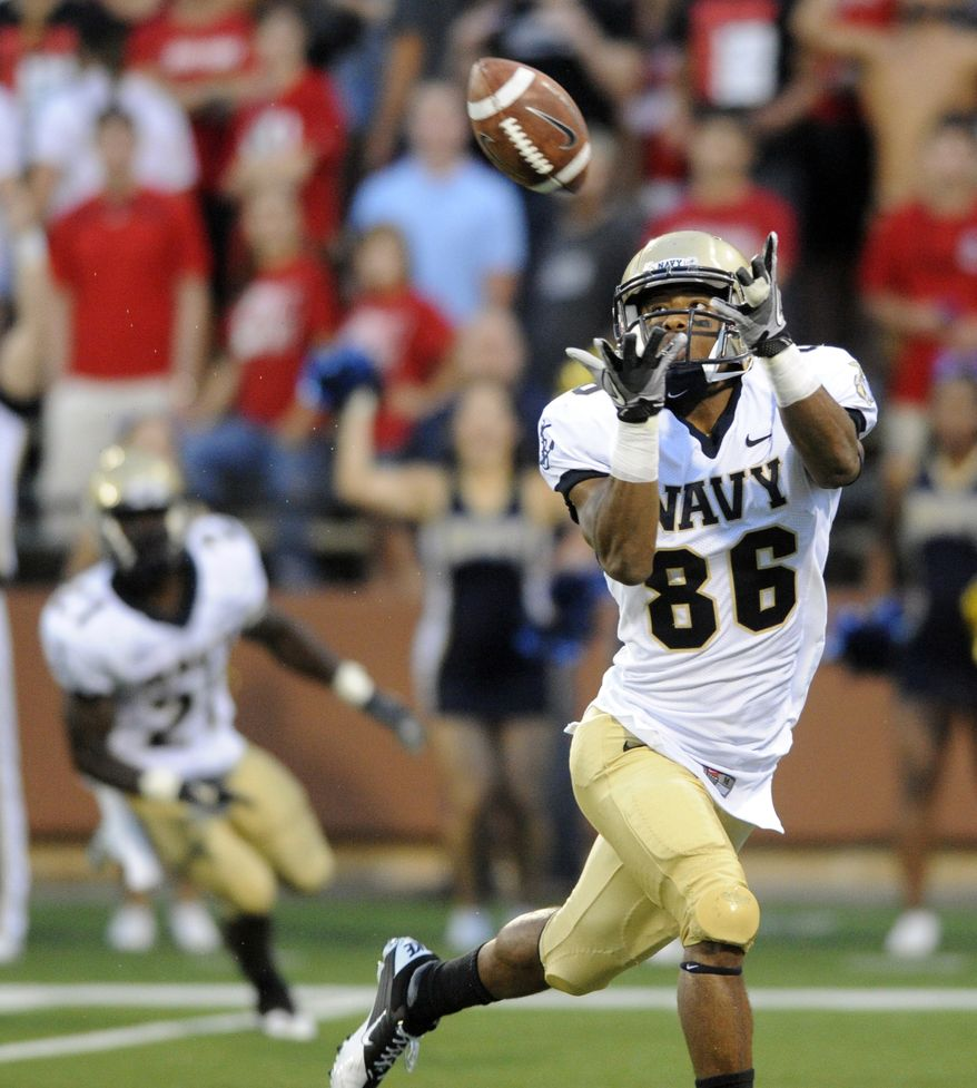 Navy's Brandon Turner hauls in a touchdown pass against Western Kentucky on Saturday, Sept. 10, 2011, in Bowling Green, Ky. (AP Photo/Daily News, Joe Imel)