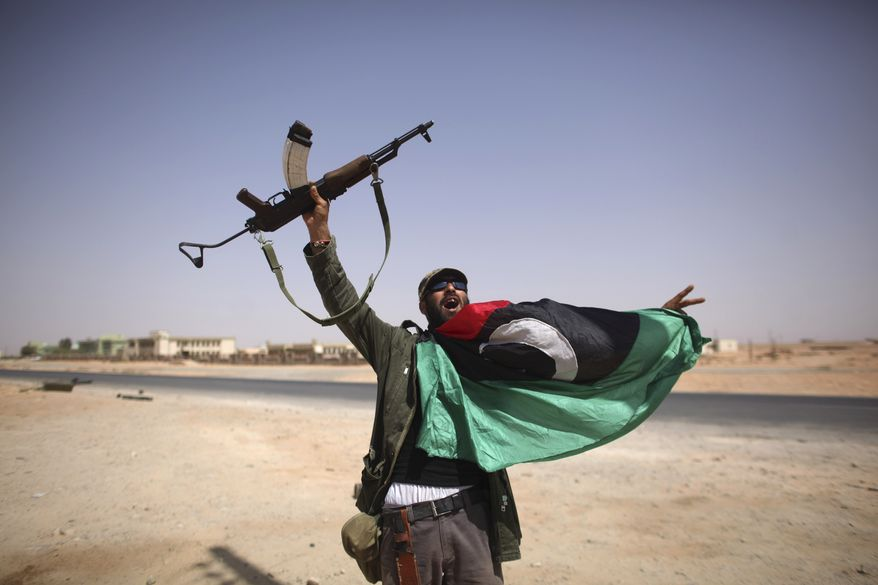 A Libyan fighter celebrates in Bani Walid, Libya, on Sept. 16, 2011. Libyan fighters streamed into Bani Walid, one of the remaining bastions of ousted leader Moammar Gadhafi, in a new fierce push. (Associated Press)