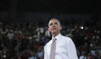 President Obama looks up into the audience after speaking Sept. 14, 2011, about his American Jobs Act legislation at North Carolina State University in Raleigh, N.C. (Associated Press)
