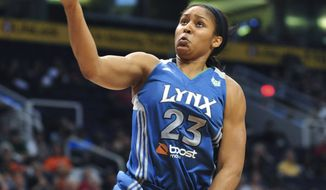 Minnesota Lynx forward Maya Moore was chosen as the WNBA rookie of the year on Friday, Sept. 16, 2011, while coach Cheryl Reeve was named coach of the year. (AP Photo/Chris Morrison, File)