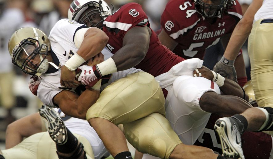 Navy fullback Alexander Teich had 15 carries for 93 yards and a touchdown in the 24-21 loss to South Carolina on Saturday. (AP Photo/Brett Flashnick)