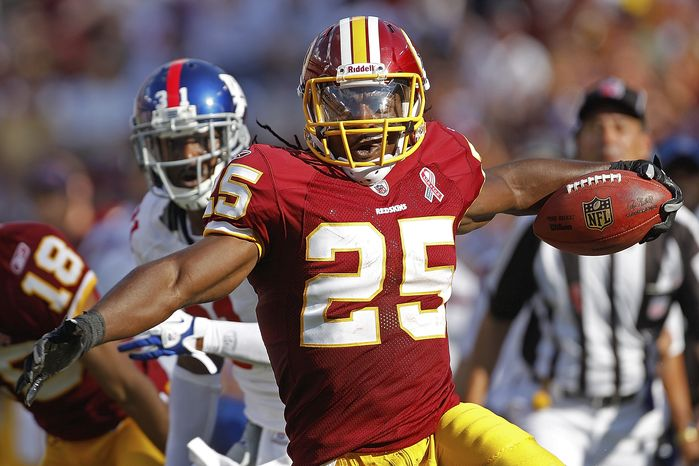 Washington Redskins running back Tim Hightower had 23 touchdowns in three years for the Arizona Cardinals. He ran for 72 yards and a touchdown against the New York Giants in Week 1 of the 2011 season. (AP Photo/Evan Vucci)
