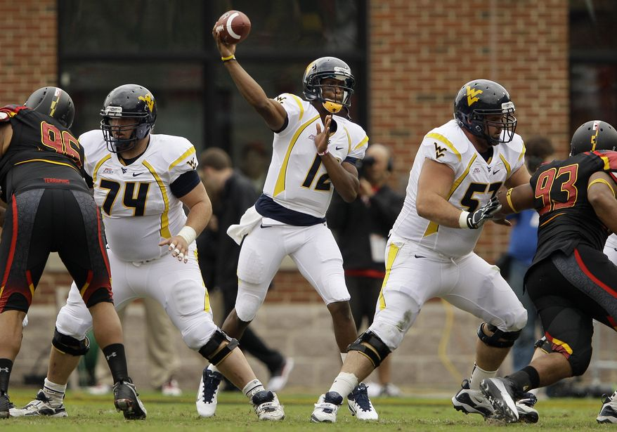 West Virginia quarterback Geno Smith threw for a career-high 388 yards in West Virginia's 37-31 win over Maryland. He had one touchdown and an interception. (Associated Press)