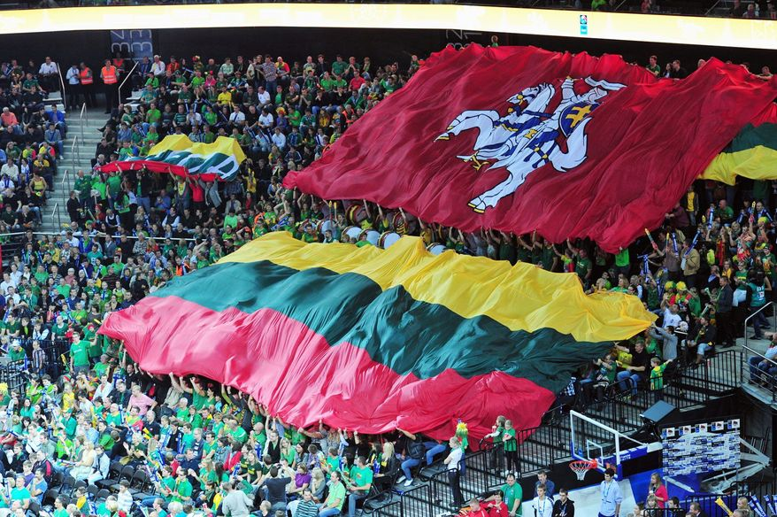 Lithuanian fans unfurl flags as they revel in the game. (Christopher Johnson/Special to The Washington Times)