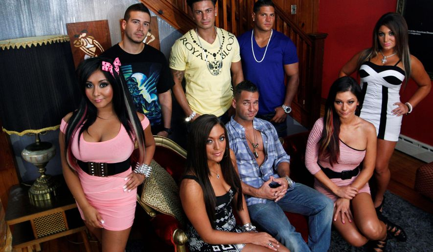 "Cast members of MTV's ""Jersey Shore"" pose at their television home in Seaside Heights, N.J. The New Jersey state Economic Development Authority approved covering $420,000 of the production costs for the reality series' inaugural 2009 season. (Associated Press)"