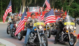 Bikers escort a New York City firetruck and a steel beam from the wreckage of the World Trade Center to a reception Thursday to kick off Lt. Dan Weekend in Beaufort, S.C. A golf tournament, a concert by the Lt. Dan Band and an art exhibit were among events that honored military personnel and veterans (Associated Press)