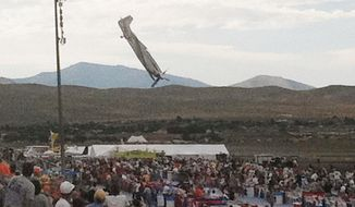 A P-51 Mustang airplane approaches the ground right before crashing during an air show in Reno, Nev., on Friday, Sept. 16, 2011. The vintage World War II-era fighter plane piloted by Jimmy Leeward plunged into the grandstands during the popular annual air show. (AP Photo/Garret Woodson)
