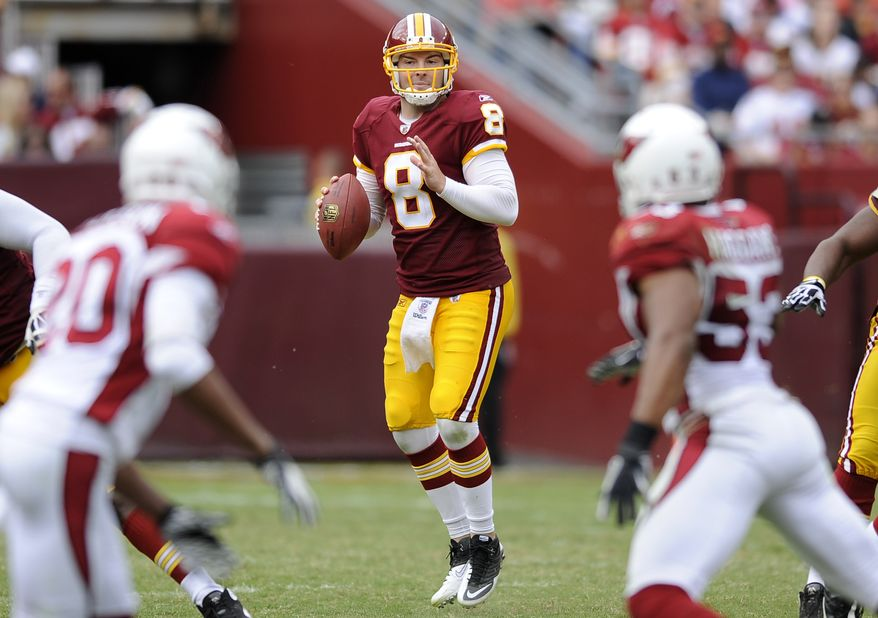 Washington Redskins quarterback Rex Grossman (8) looks for a receiver in the second half of an NFL football game against the Arizona Cardinals in Landover, Md., Sunday, Sept. 18, 2011. (AP Photo/Nick Wass)