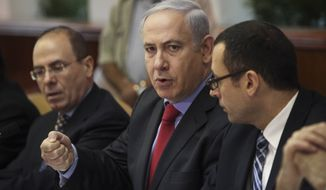 ** FILE ** Israeli Prime Minister Benjamin Netanyahu (center) speaks during a weekly Cabinet meeting in Jerusalem on Sunday, Sept. 18, 2011. Also attending are Cabinet Secretary Zvi Houser (right) and Deputy Prime Minister Silvan Shalom (left). (AP Photo/Tara Todras-Whitehill, Pool)