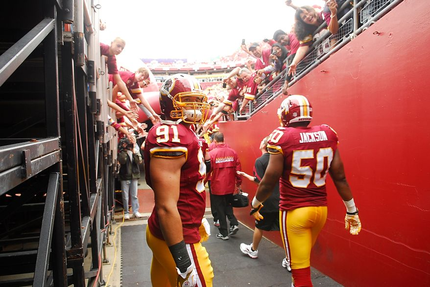 Washington Redskins rookie linebacker Ryan Kerrigan (91) and linebacker Rob Jackson (50) head onto the field to face the Arizona Cardinals at FedEx Field in Landover, Md., on Sunday, Sept. 18, 2011. (Andrew Harnik/The Washington Times)