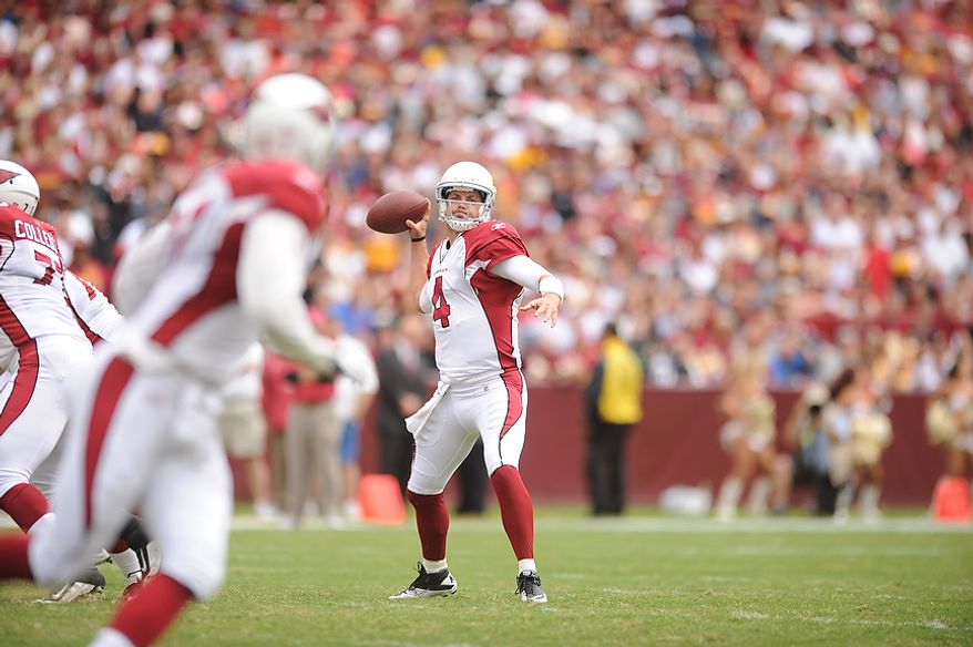 Arizona Cardinals quarterback Kevin Kolb (4) throws a 21-yard touchdown pass to tight end Jeff King (foreground) during the first quarter of a game with the Washington Redskins at FedEx Field in Landover, Md., on Sunday, Sept. 18, 2011. (Andrew Harnik/The Washington Times)