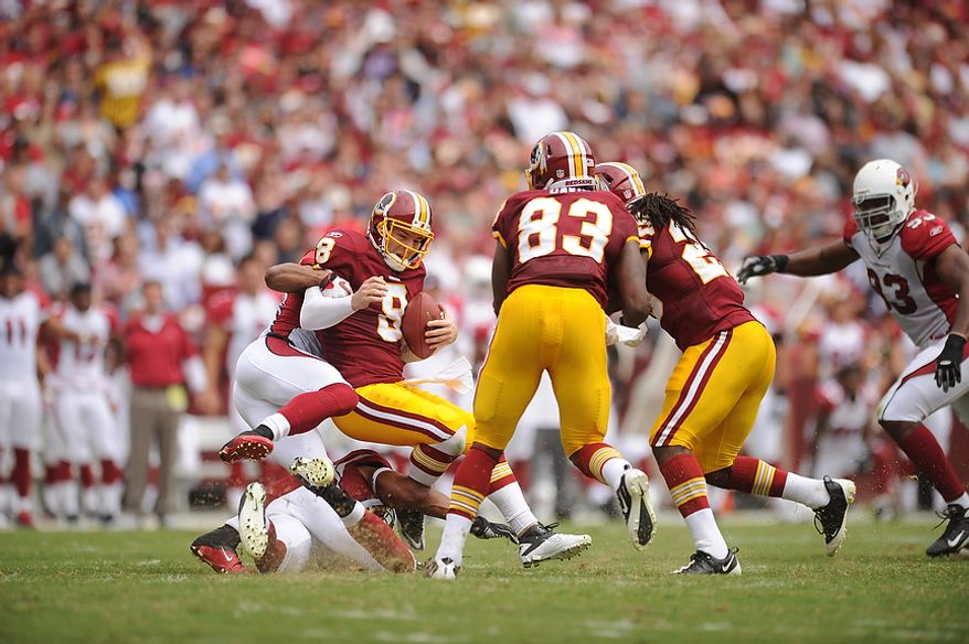 Arizona Cardinals free safety Kerry Rhodes (24), sacks Redskins' quarterback Rex Grossman for a loss during the first quarter at FedEx Field in Landover, Md., on Sunday, September 18, 2011. (Andrew Harnik/The Washington Times)