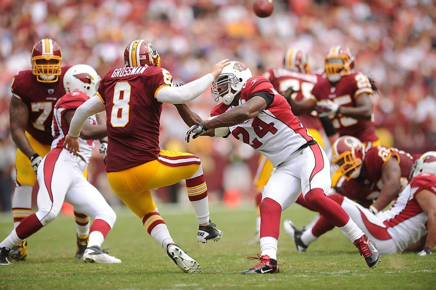 Arizona Cardinals strong safety Adrian Wilson (24), pressures Redskins' quarterback Rex Grossman during the third drive of the first quarter at FedEx Field in Landover, Md., on Sunday, September 18, 2011. (Andrew Harnik/The Washington Times)