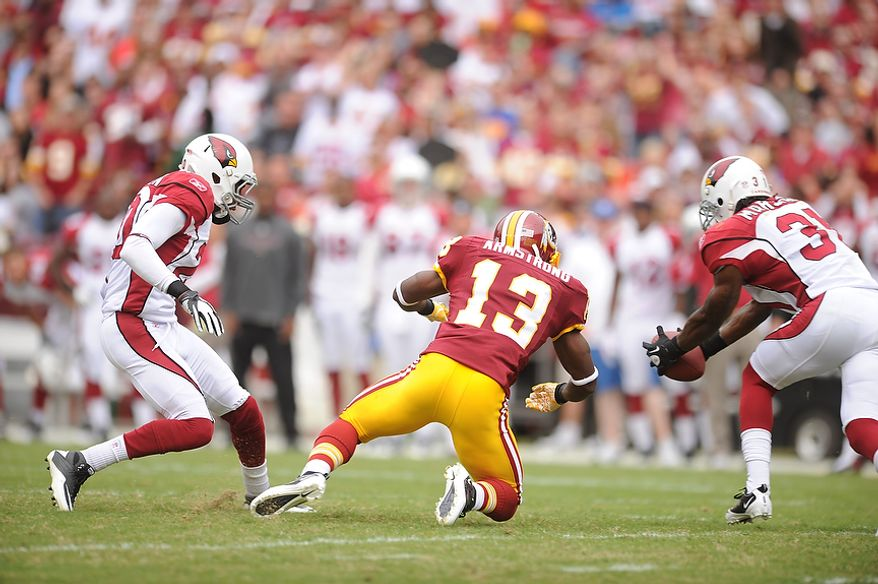 The Redskins'  second drive is halted as quarterback Rex Grossman's pass is picked off by Cardinals' cornerback Richard Marshall at the Arizona 39 yard-line for Grossman's second interception of the first quarter at FedEx Field in Landover, Md., on Sunday, September 18, 2011. (Andrew Harnik/The Washington Times)