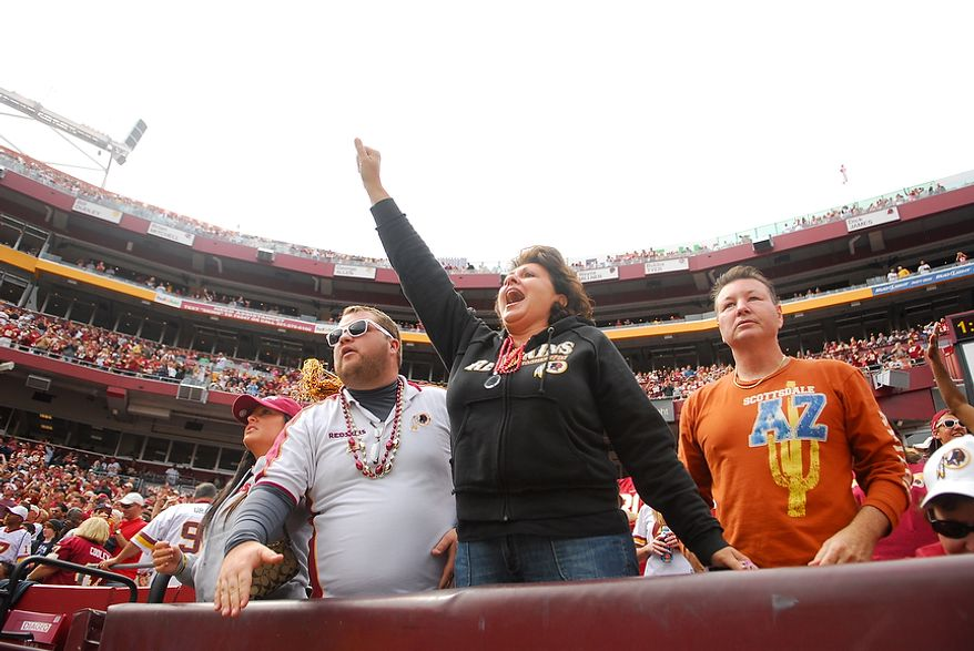 Redskins fans cheer during the second quarter of Washington's contest with the Arizona Cardinals at FedEx Field in Landover, Md., on Sunday, September 18, 2011. (Andrew Harnik/The Washington Times)