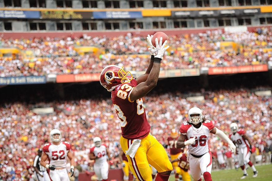 Redskins tight end Fred Davis (83) catches a one-yard touchdwon pass from quarterback Rex Grossman in the second quarter against the Arizona Cardinals at FedEx Field in Landover, Md., on Sunday, September 18, 2011. (Andrew Harnik/The Washington Times)
